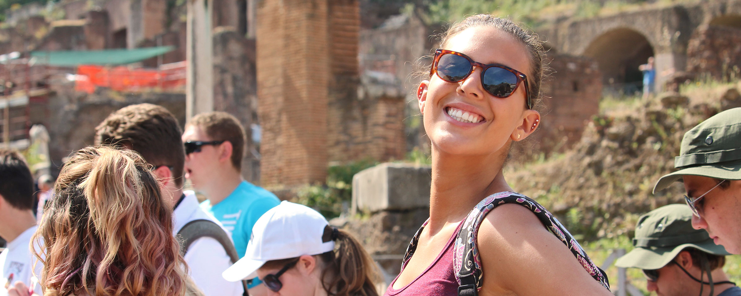 student in rome smiling