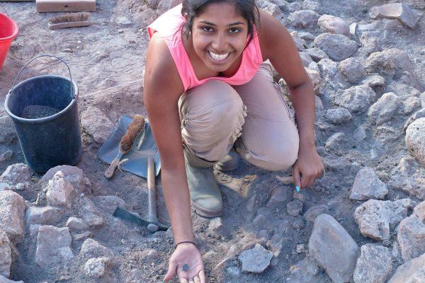 Female Student Digging
